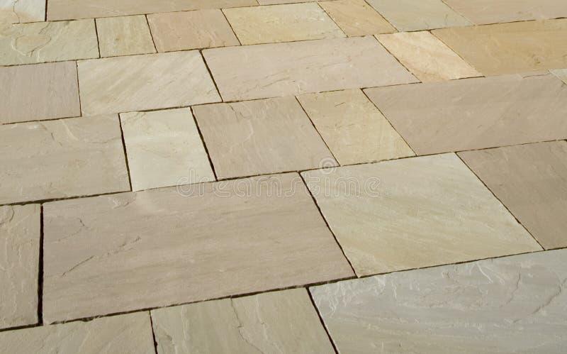 Paving. New stone slab pavement pattern stock photos