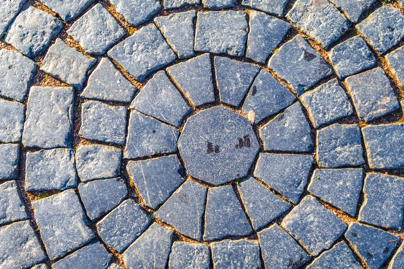Paving. Square cobblestone circular pattern. Pavement in Vintage Design Flooring Square Pattern Texture Background. royalty free stock photo