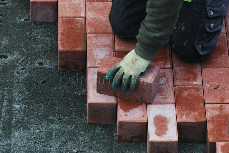 Paving stone. Is being placed stock photo