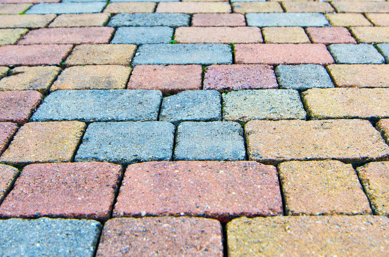 Paving stone bricks. Of different colors and of irregular composition royalty free stock photo