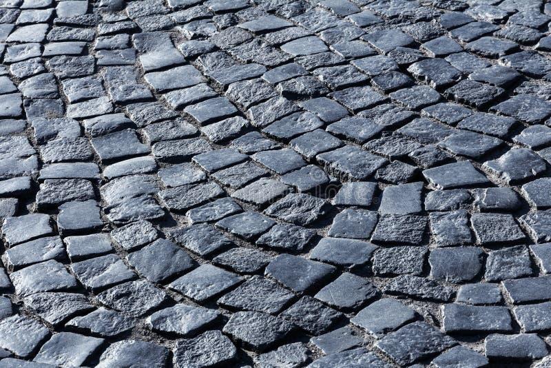 Paving stone. Dark paving stone. fragment of historic pavement pedestrian promenade royalty free stock photos