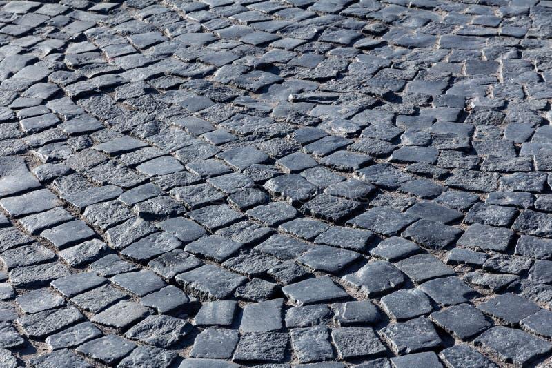 Paving stone. Dark paving stone. fragment of historic pavement pedestrian promenade stock photography