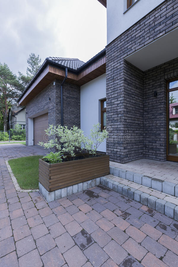 Paving stone doorway to modern house. Modern front house entrance with paving stone doorway stock photo