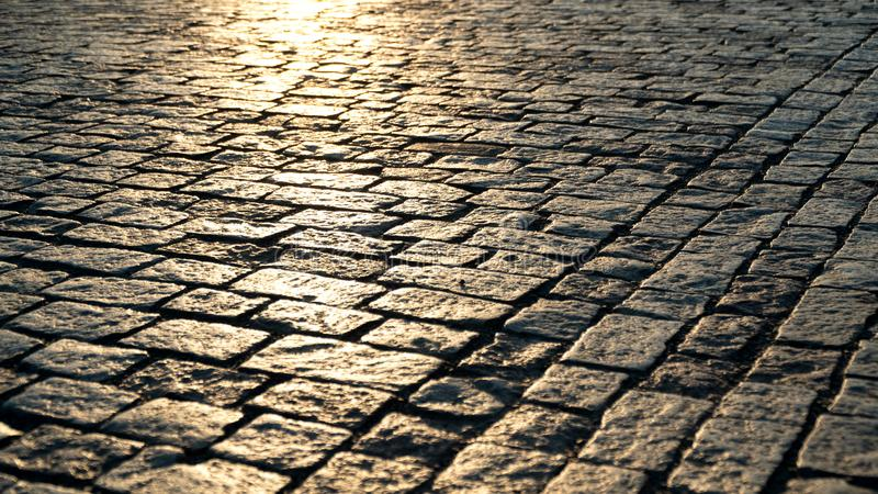 Paving stone and sunlight. Paving stone close up and sunlight at dawn royalty free stock image