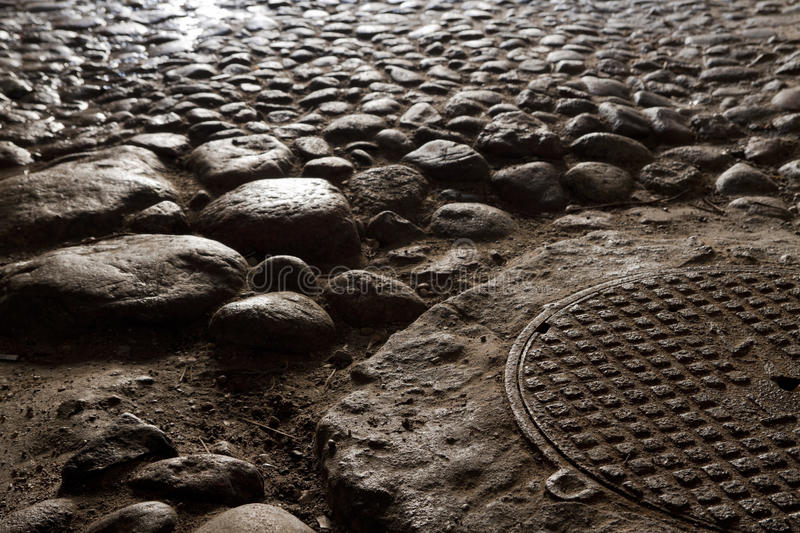 Paving stones. Lighted by the evening sun stock images