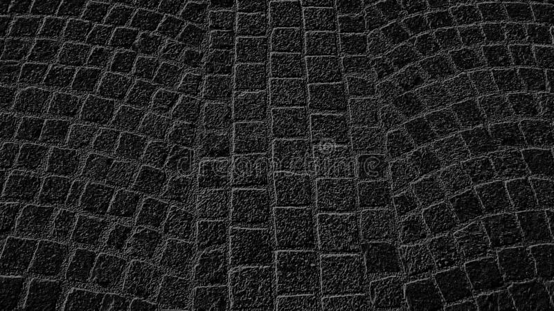 Paving stones in an ancient square in the city. Black background with gray pattern. Monochrome image. Abstract, antique, antiquity, art, backdrop, closeup stock image