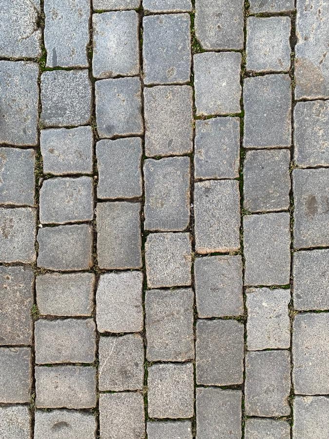 Paving texture. Old natural grey granite paving texture royalty free stock photos