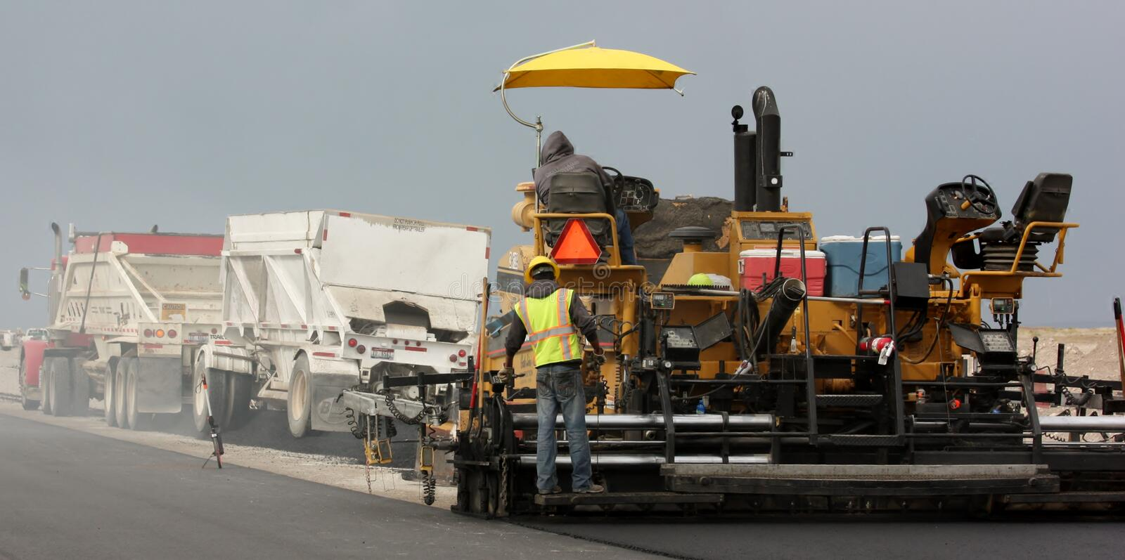 Paving with trucks royalty free stock photos