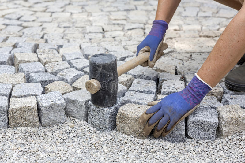 Paving works with granite stones. Paving works with new granite stones royalty free stock photography