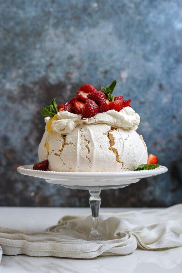 Pavlova - delicious crunchy cake with fruits royalty free stock image