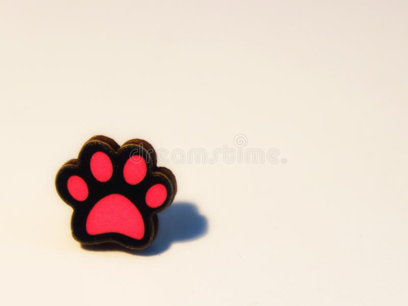 Paw concept red white stock image