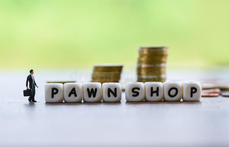 Pawn shop concept - Businessman financial borrow loan pawn for cash with coin background stock images