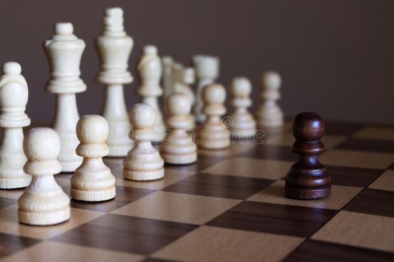 Pawn stand against enemy team. Business leadership concept. Chess pawn stand against enemy team. Business leadership concept. Copy space royalty free stock image