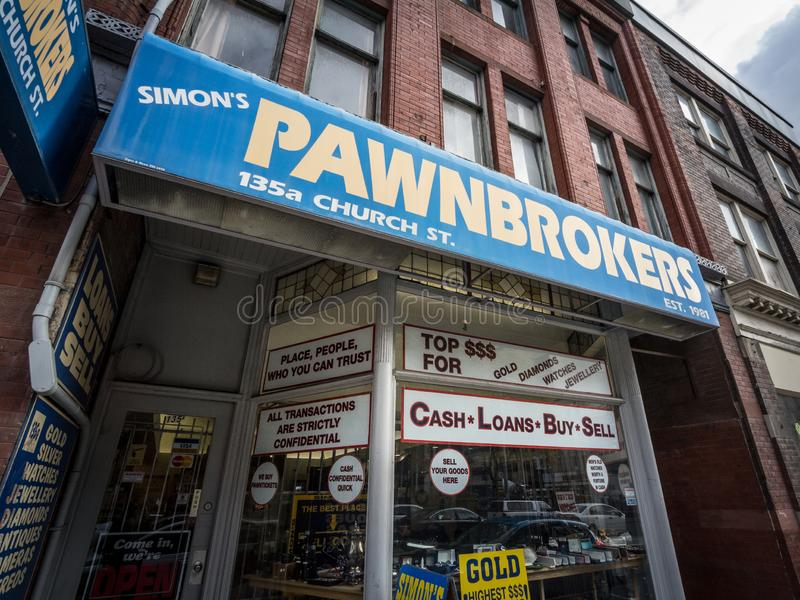Pawnbroker main entrance in downtown Toronto. A Pawn Shop is a business offering loans & money in exchange of objects royalty free stock images