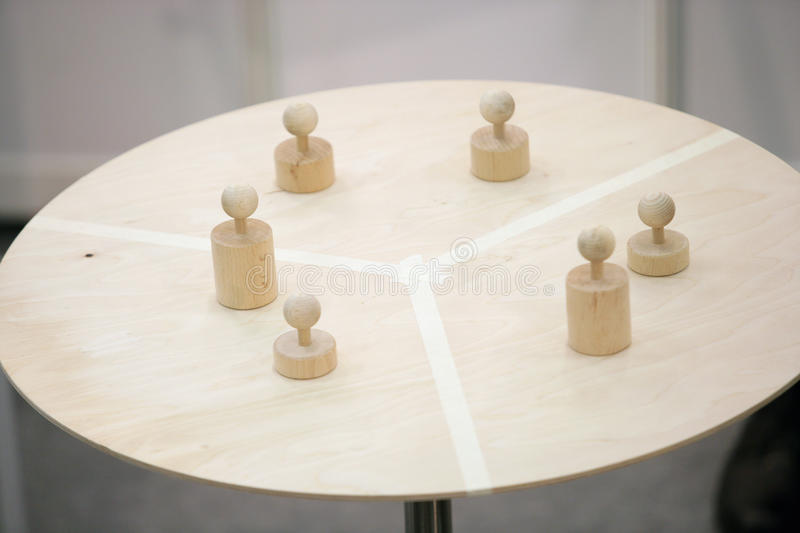 Download Pawns On Round Table Stock Image - Image: 14664321