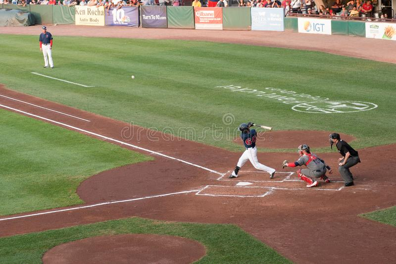 Pawtucket Red Sox Baseball Game. Player hitting ball at Pawtucket Red Sox baseball Game in Rhode Island royalty free stock photography