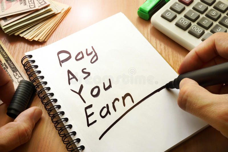 Pay As You Earn – PAYE. Pay As You Earn – PAYE written in a note royalty free stock image