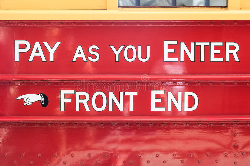 Pay as you enter - front end. Text on an old touristic tram in Christchurch, New Zealand: pay as you enter - front end stock images