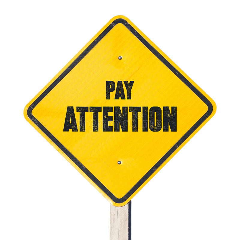 Pay attention sign stock images