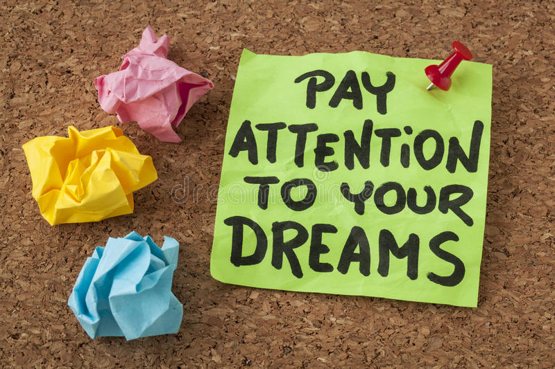 Pay attention to your dreams. Motivation or self improvement concept - handwriting on colorful sticky notes royalty free stock images