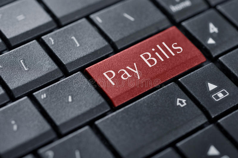 Pay bills button. Words Pay bills on button of computer keyboard stock image