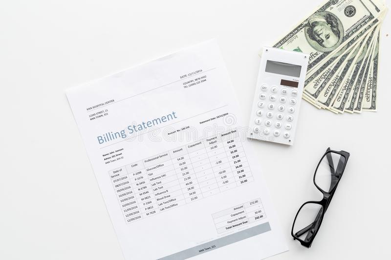 Pay bills and taxes. Billing statement, calculator, money on white background top view copy space. Pay bills and taxes. Billing statement, calculator, money on stock photo