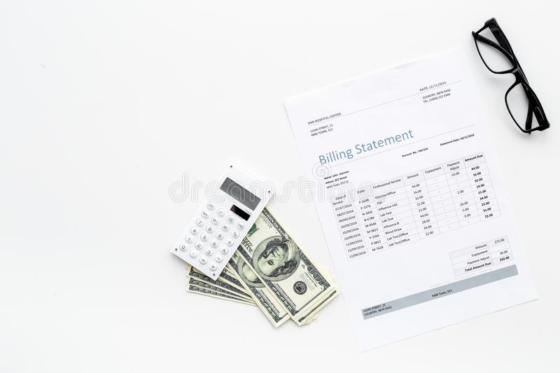 Pay bills and taxes. Billing statement, calculator, money on white background top view copy space. Pay bills and taxes. Billing statement, calculator, money on stock photography