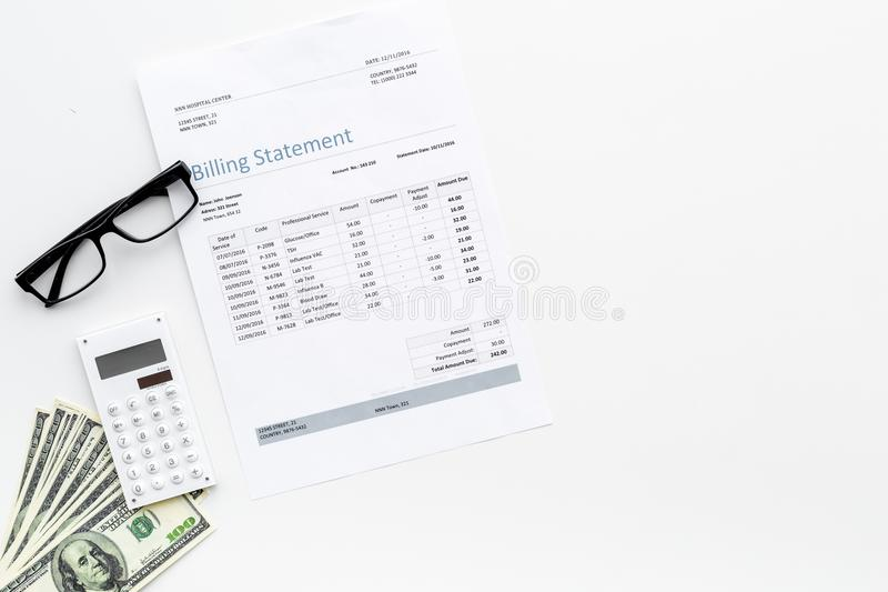 Pay bills and taxes. Billing statement, calculator, money on white background top view copy space. Pay bills and taxes. Billing statement, calculator, money on royalty free stock photos