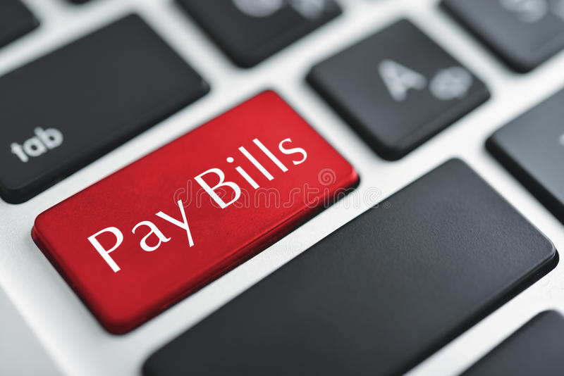 Pay bills. Words Pay bills on button of computer keyboard royalty free stock image