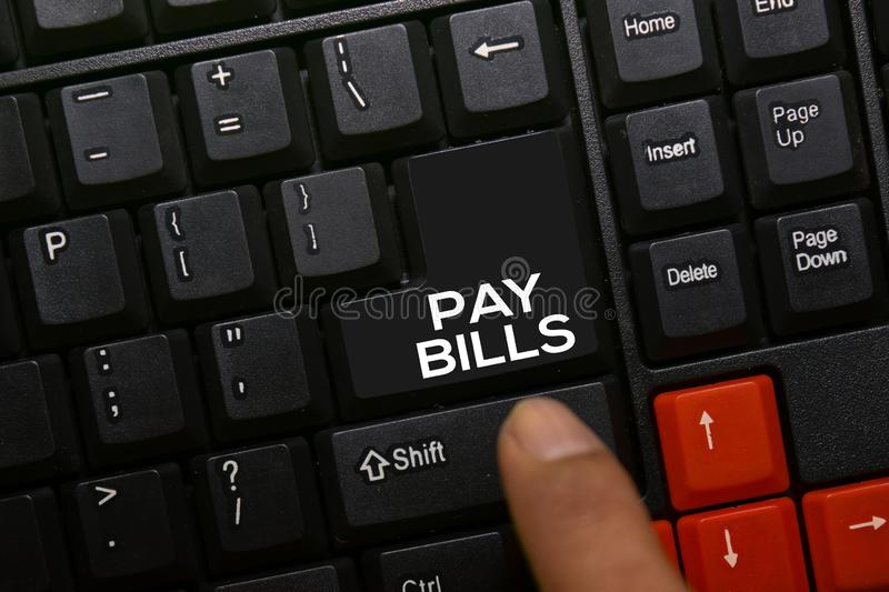 Pay Bills write on keyboard isolated on laptop background royalty free stock photography