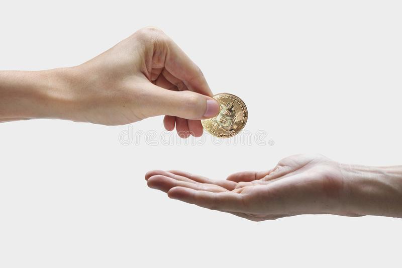 Pay bitcoin, hand use bitcoin digital technology on a white back. Ground, currency blockchain technology concept royalty free stock photography