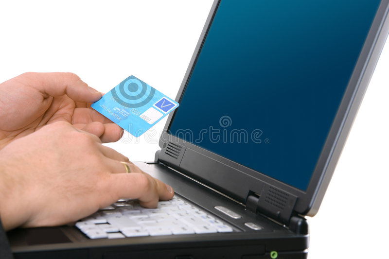 Pay With Credit Card. Hands on the laptop; paying with credit card