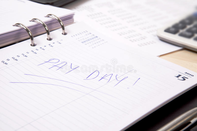 Pay day. Written on the diary stock photography