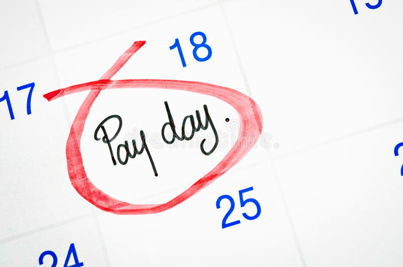 Pay day on calendar. Pay day written with red mark on a calendar page royalty free stock images