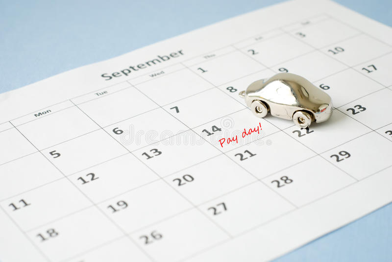Pay day. Car loan pay day on calendar royalty free stock photography