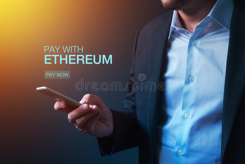 Pay with Ethereum cryptocurrency stock photography