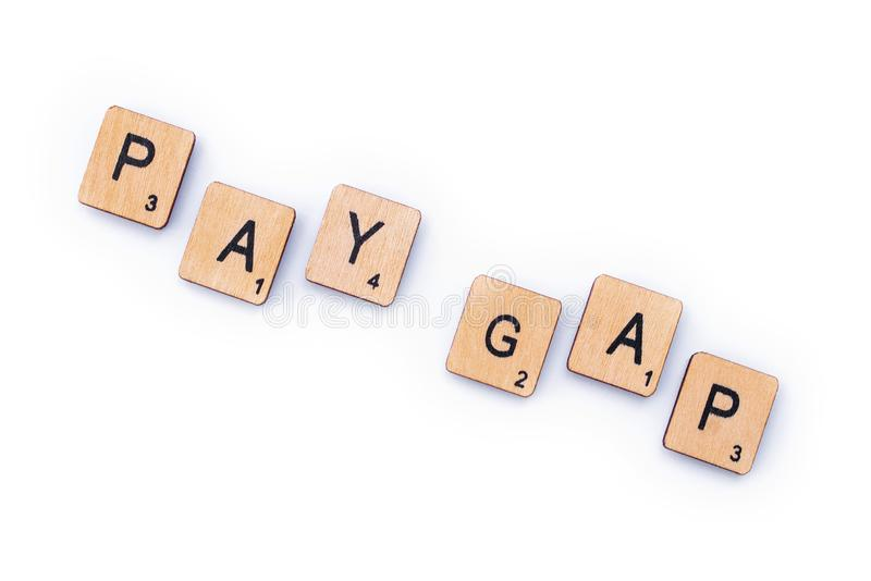 PAY GAP. London, UK - February 6th 2019: PAY GAP, spelt out with wooden letter tiles royalty free stock photo