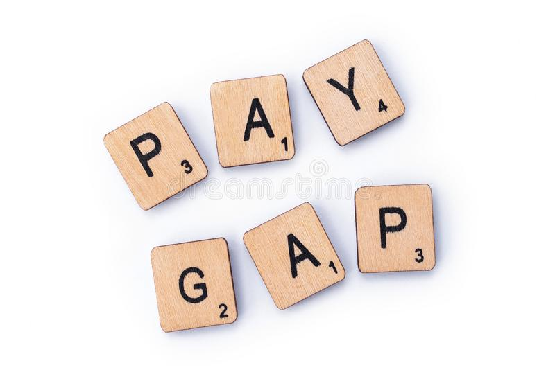 PAY GAP. London, UK - February 6th 2019: PAY GAP, spelt out with wooden letter tiles royalty free stock images