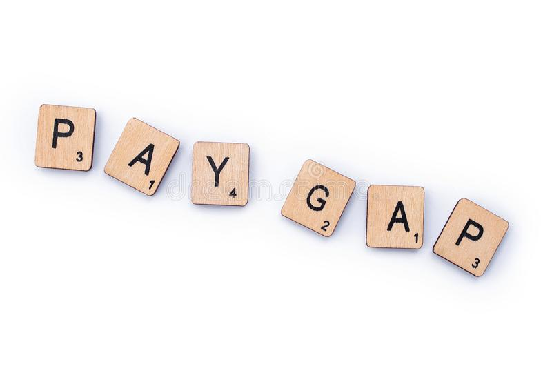 PAY GAP. London, UK - February 6th 2019: PAY GAP, spelt out with wooden letter tiles stock photos