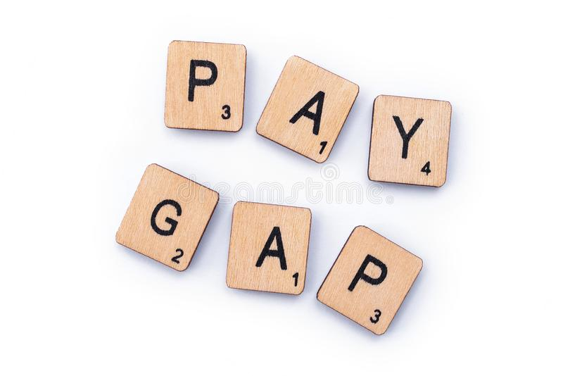 PAY GAP. London, UK - February 6th 2019: PAY GAP, spelt out with wooden letter tiles stock images