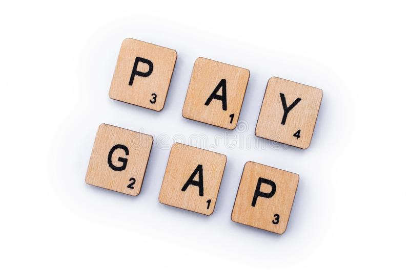 PAY GAP. London, UK - February 6th 2019: PAY GAP, spelt out with wooden letter tiles royalty free stock photos