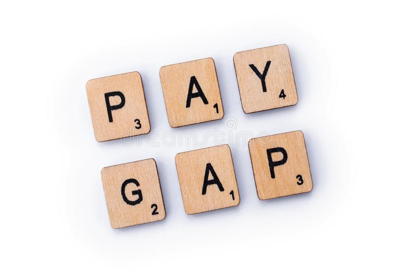 PAY GAP. London, UK - February 6th 2019: PAY GAP, spelt out with wooden letter tiles royalty free stock image