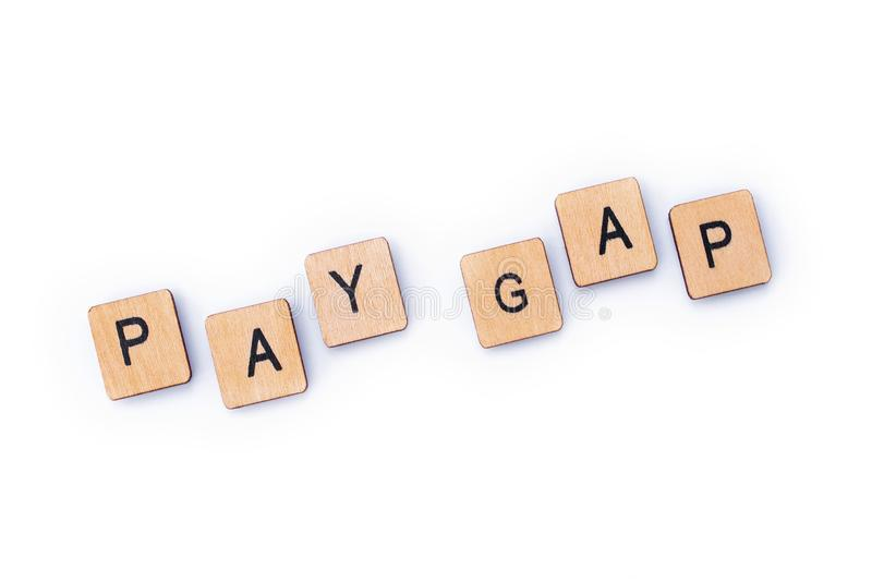 PAY GAP. Spelt out with wooden letter tiles stock photo