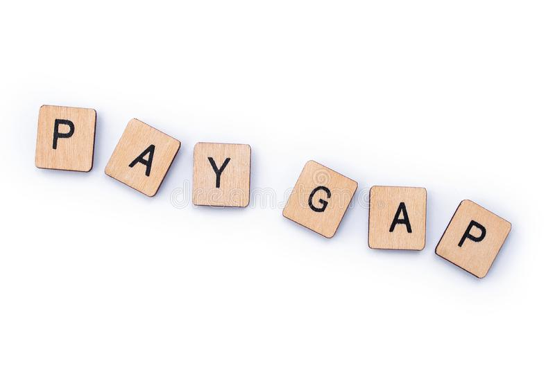 PAY GAP. Spelt out with wooden letter tiles royalty free stock photography