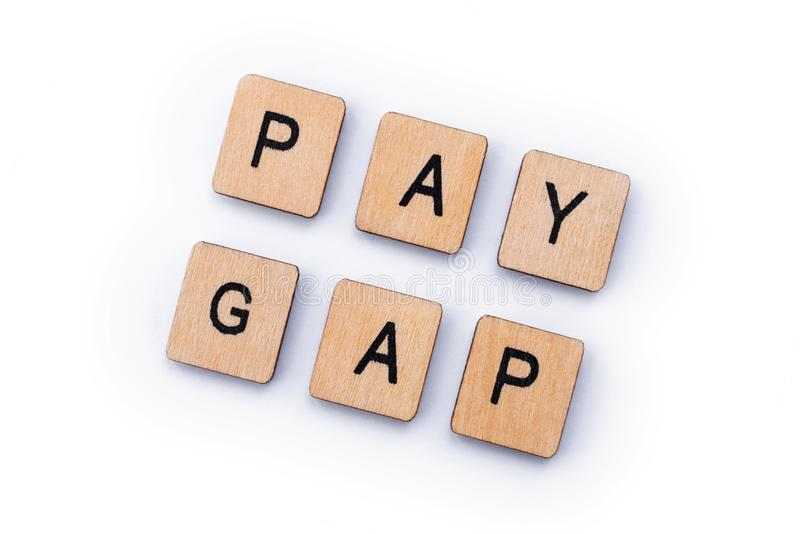 PAY GAP. Spelt out with wooden letter tiles stock photos