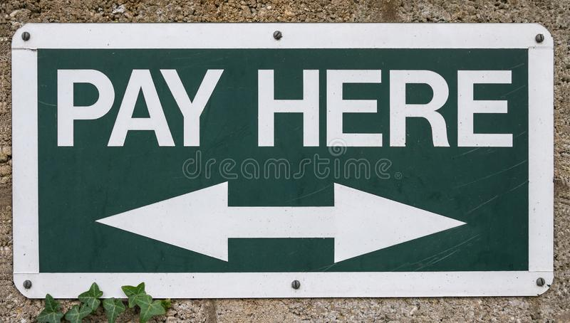Pay Here sign royalty free stock image
