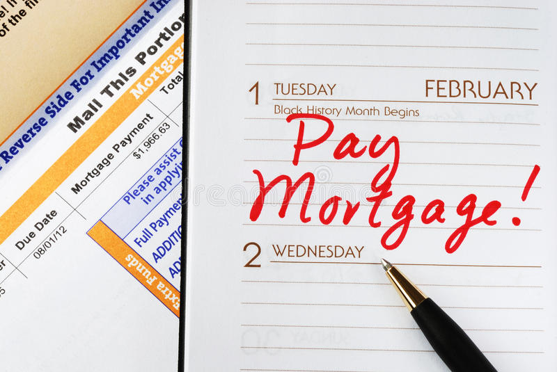 Pay the home mortgage. Be sure to pay the home mortgage on time stock photos