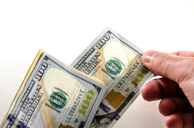 Pay my debts. A man is giving away an hundred dollar bill. symbol of wealth and luxury royalty free stock photo