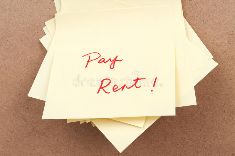 Pay rent words. Written on sticky note stock photos