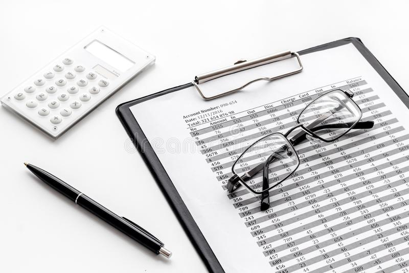 Pay taxes for business on office work desk with glasses and calculator white background stock photography